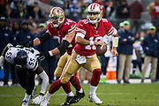 San Francisco 49ers quarterback Jimmy Garoppolo (10) looks for an open receiver in the final minute of gameplay against the Seattle Seahawks at Levi's Stadium in Santa Clara, Calif., on November 26, 2017. (Stan Olszewski/Special to S.F. Examiner)