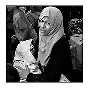 Faces of Mosul<br /> <br /> A collection of images from 4 time Pulitzer prize winning photographer Carol Guzy, gives us a glimpse into the faces of those affected by the fierce conflict with ISIS in Mosul. Wounded and weak, most who survived now face an uncertain future in the limbo of IDP camps. Shattered lives, lost loved ones and escape from the rubble of collapsed homes and the evil of ISIS doctrine, leaves scars of emotional trauma even more difficult to heal. The war in Mosul is over, but the humanitarian crisis continues.<br /> <br /> Mosul, Iraq - A woman named ALIA holds the body of her 12-year-old child ULA who passed away on the truck to a Trauma Stabilization Point two hours previously. She said it was from lack of food and water as they were trapped in the Old City during the battle with ISIS. Her husband died from a mortar. She clutched the tiny body and would not let medics take her, hoping to bury her child with relatives in East Mosul.  Civilians, many injured and weak, flee continued battle with ISIS in West Mosul amid ruins of the city<br />  &copy;Carol Guzy/zReportage.com/Exclusivepix Media