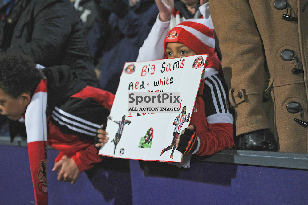 A young Sunderland fan holds up a sign during Crystal Palaces clash with Sunderland in the Barclays Premier League at Selhurst Park