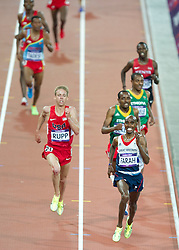 © Licensed to London News Pictures. 06/06/2012. London,Britain.Mo Farah competes and wins the gold medal in the Men's 10000m, at the Olympic Stadium, in London, during the London 2012 Olympic Games.  Photo credit : Bogdan Maran/LNP/BPA