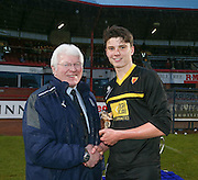 Dave Forbes presents the man of the match award to Grove Academy's Mark Smith after his side had beaten St Johns RC High School in the Under 15s senior cup final at Dens Park - Under 15s senior cup final sponsored by Dundee FC Supporters Society<br /> <br />  - &copy; David Young - www.davidyoungphoto.co.uk - email: davidyoungphoto@gmail.com