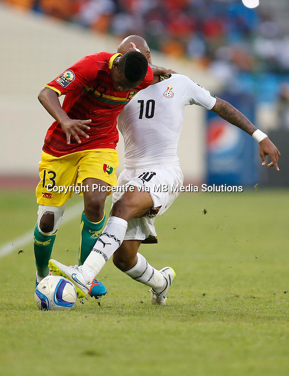 Abdoulaye Cisse of Guinea shields the ball against Jordan Ayew of Ghana during their AFCON 2015 Quarter Finals Match on February 1 2015 at Estadio de Malabo Equatorial Guinea. Ghana won 3-0. Photo/Mohammed Amin/www.pic-centre.com (Equatorial Guinea)