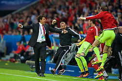 LILLE, FRANCE - Friday, July 1, 2016: Wales manager Chris Coleman celebrates his sides equalising first goal against Belgium, to level the score 1-1, during the UEFA Euro 2016 Championship Quarter-Final match at the Stade Pierre Mauroy. goalkeeping coach Martyn Margetson, goalkeeper Daniel Ward and Owain Fon Willaims. (Pic by Paul Greenwood/Propaganda)