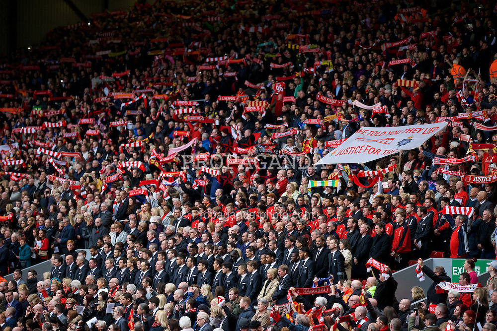 """LIVERPOOL, ENGLAND - Friday, April 15, 2016: Liverpool players and supporters on the Spion Kop sing the club's anthem """"You'll Never Walk Alone"""" during the 27th Anniversary Hillsborough Service at Anfield. (Pic by David Rawcliffe/Propaganda)"""