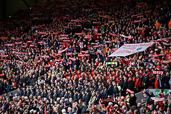 "LIVERPOOL, ENGLAND - Friday, April 15, 2016: Liverpool players and supporters on the Spion Kop sing the club's anthem ""You'll Never Walk Alone"" during the 27th Anniversary Hillsborough Service at Anfield. (Pic by David Rawcliffe/Propaganda)"