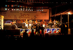Stock photo of a band playing on stage at night at the International Festival in downtown Houston Texas