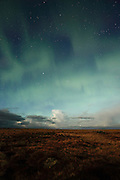 Vague northern lights (aurora borealis) seen over the Reykjanes Peninsula on a moonlit night