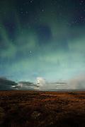 Vague northern lights (aurora borealis) seen over the Reykjanes Peninsula on a moonlit night