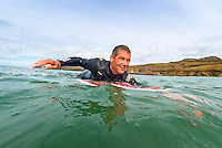 Male surfer riding wave<br /> Whitesands Bay<br /> Near St David's<br /> Surfing<br /> Pembrokeshire<br /> South<br /> Activities and Sports