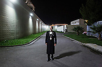LECCE, ITALY - 10 NOVEMBER 2016: Roberto Giannone, a trained sommelier and volunteer to lecture to female inmates on the arts and crafts of wine tasting and serving, poses for a portrait along the internal path of the largest penitentiary in the southern Italian region of Apulia, holding 1,004 inmates in the outskirts of Lecce, Italy, on November 10th 2016.<br /> <br /> Here a group of high-security inmates and aspiring sommeliers are taking a course of eight lessons to learn how to taste, choose and serve local wines.<br /> <br /> The classes are part of a wide-ranging educational program to teach inmates new professional skills, as well as help them develop a bond with the region they live in.<br /> <br /> Since the 1970s, Italian norms have been providing for reeducation and a personalized approach to detention. However, the lack of funds to rehabilitate inmates, alongside the chronic overcrowding of Italian prisons, have created a reality of thousands of incarcerated men and women with little to do all day long. Especially those with a serious criminal record, experts said, need dedicated therapy and professionals who can help them.