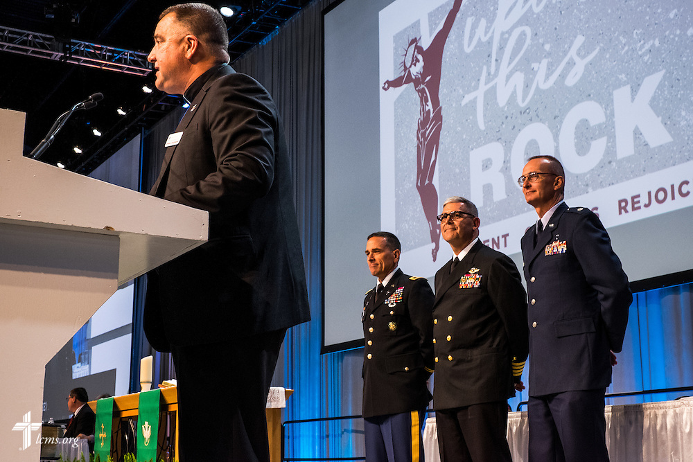 The Rev. Craig G. Muehler, director of the LCMS Ministry to the Armed Forces introduces chaplains on Monday, July 11, 2016, at the 66th Regular Convention of The Lutheran Church–Missouri Synod, in Milwaukee. Behind him are Chaplain (Col.) Jonathan E. Shaw, U.S. Army, Chaplain (Capt.) Gregory N. Todd, U.S. Coast Guard, and Chaplain (Lt. Col.) Gregory D. Jans, U.S. Air Force. LCMS/Frank Kohn
