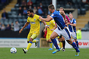 AFC Wimbledon striker Andy Barcham (17) runs forward ahead of Rochdale FC defender Jim McNulty (4) during the EFL Sky Bet League 1 match between Rochdale and AFC Wimbledon at Spotland, Rochdale, England on 27 August 2016. Photo by Stuart Butcher.