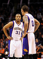 Jan. 14, 2013; Phoenix, AZ, USA; Phoenix Suns guard Sebastian Telfair (31) and forward Michael Beasley (0) talk on the court during the game against the Oklahoma City Thunder in the first half at US Airways Center.  The Thunder defeated the Suns 102-90. Mandatory Credit: Jennifer Stewart-USA TODAY Sports