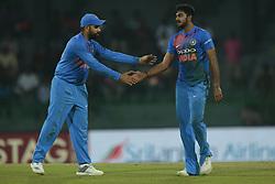 March 8, 2018 - Colombo, Sri Lanka - Indian cricket captain Rohit Sharma congratulates Vijay Shankar  during the 2nd T20 cricket match of NIDAHAS Trophy between India  and Bangladesh at R Premadasa cricket ground, Colombo, Sri Lanka on Thursday 8 March 2018. (Credit Image: © Tharaka Basnayaka/NurPhoto via ZUMA Press)