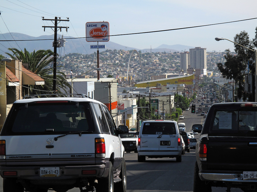 Tijuana Mexico ..traffic in Tijuana..While working on this long term project 'La Frontera' I want to examine the cultural and humanitarian activities on both sides of a border that keeps the United States and Mexico apart with a wall of steel already 600 miles long. The turf wars of drug cartels, arms trafficking and rampant kidnappings turned cities like Tijuana into some of the most dangerous places on earth. Despite the violence many brave artists, photographers, architects, poets, humanitarians, teachers etc live and work in the shadow of the wall on both sides and have a positive influence on this region; they are the focus of my long term project along the border. (Over time I plan to cover the entire length from the Atlantic to the Pacific, these images were taken in and around Tijuana).© Stefan Falke