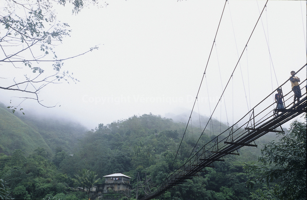 HANGING BRIDGE NEAR TINGLAYEN,  KALINGA PROVINCE, NORTH LUZON, THE PHILIPPINES