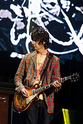 © licensed to London News Pictures . 30/06/2012 . Manchester , UK . John Squire playing with The Stone Roses on stage at Heaton Park during the band's comeback event . Photo credit : Joel Goodman/LNP