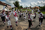 Thaxted Morris Weekend 3-4 June 2017<br />A meeting of member clubs of the Morris Ring celebrating the 90th anniversary of the founding of the Thaxted Morris Dancing side or team in Thaxted, North West Essex, England UK. <br />Mass dancing from different Morris sides at The Fox in Finchingfield Essex.<br /><br />Hundred of Morris dancers from the UK and this year the Silkeborg side from Denmark spend most of Saturday dance outside pubs in nearby villages where much beer is consumed. In the late afternoon all the sides congregate in Thaxted where massed dancing is perfomed along Town Street. As darkness falls across Thaxted the spell binding Abbots Bromley Horn Dance is performed to the sound of a solo violin in the dark.