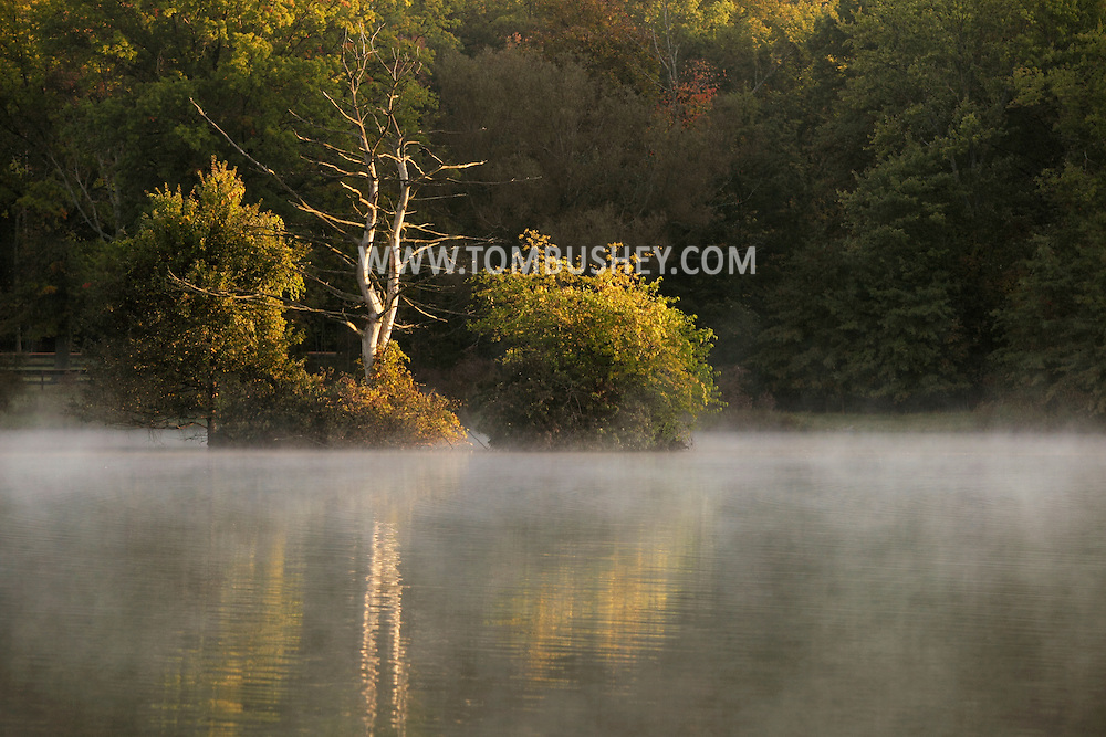 Middletown, NY - Early morning mist rises off a lake on Oct. 2, 2009.
