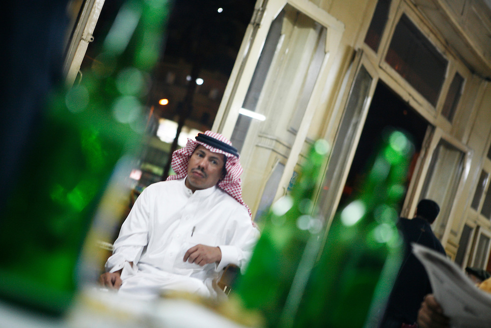 A man dressed in traditional clothes drinks beer at the Cafe Hurriya (Free Cafe) in Cairo.