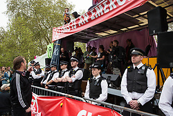 London, UK. 23rd April 2019. Metropolitan Police officers surround the stage in front of Extinction Rebellion climate change activists at Marble Arch.