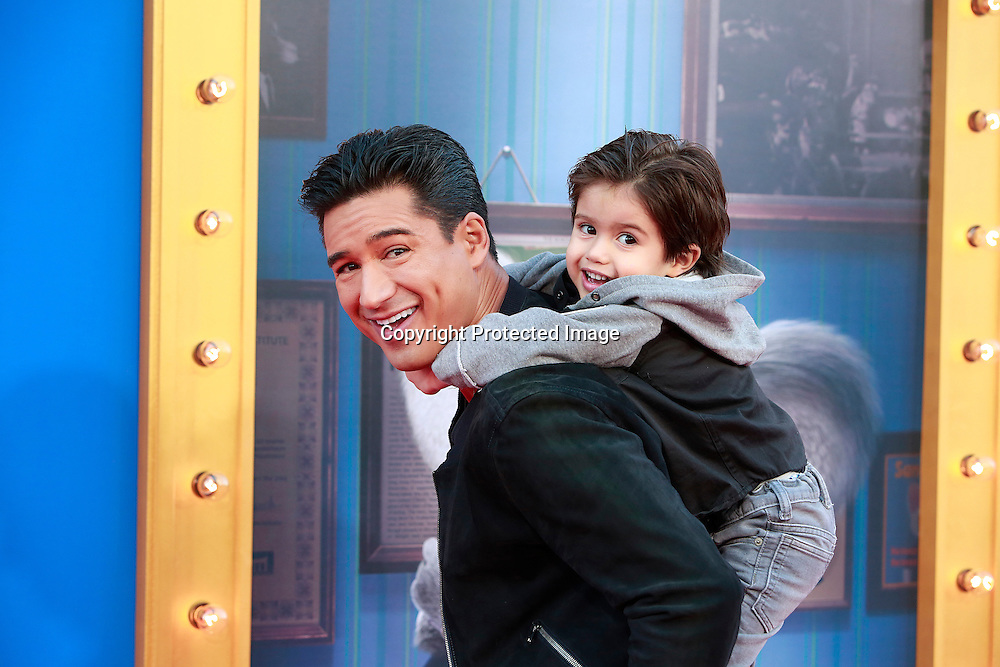 Actor/host Mario Lopes and son Domunic attend Universal Studios world premiere Sing at Microsoft Theater at L.A. Live in Los Angeles, December 3, 2016