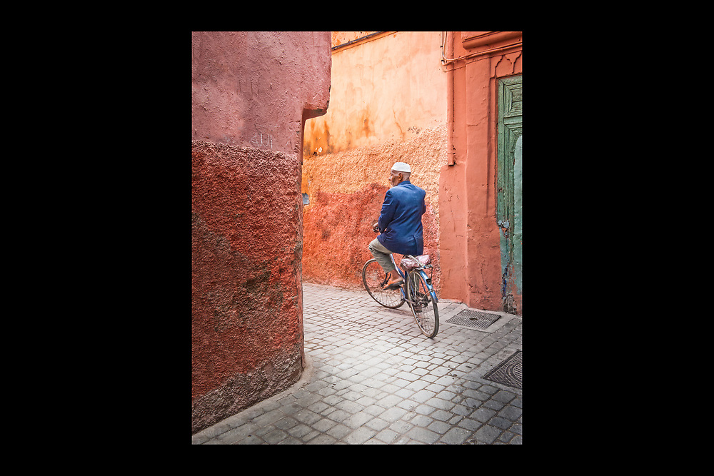 The narrow and maze-like streets of the historic medina in Marrakesh, Morocco only allow for bicycles and small scooters as the main mode of transportation in this UNESCO World Heritage Site.