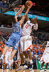 Virginia forward Jamil Tucker (12) and North Carolina forward Tyler Hansbrough (50) battle for a rebound.  The the #5 ranked North Carolina Tar Heels defeated the Virginia Cavaliers 83-61 in NCAA Basketball at the John Paul Jones Arena on the Grounds of the University of Virginia in Charlottesville, VA on January 15, 2009.