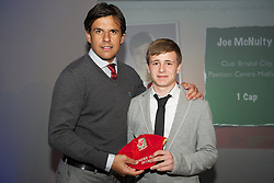 CARDIFF, WALES - Saturday, May 11, 2013: Joe McNulty is presented with his U16's cap by Wales national team manager Chris Coleman at the FAW Trust Under-16's cap presentation. (Pic by David Rawcliffe/Propaganda)