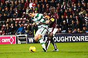 Celtic FC Midfielder Nir Bitton and Hearts FC Midfielder Morgaro Gomis battle during the Scottish League Cup presented by Ulilita Energy quarter final match between Heart of Midlothian and Celtic at Tynecastle Stadium, Gorgie, Scotland on 28 October 2015. Photo by Craig McAllister.