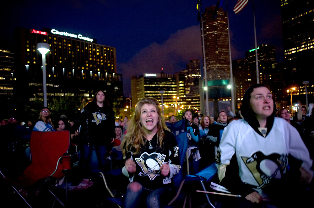 Ashley Krysinski, 20, (left) of Munhall, shrieks while watching Pittsburgh Penguins fail to score against the Montreal Canadiens on a big screen outside Mellon Arena in Pittsburgh.  The Canadiens won the game 5-2 which ended the Penquins chance for another Stanley Cup. This was the last Penguins game at Mellon Arena.  Krysinski was joined by her friend Savannah David, 21, (right) of West Mifflin.
