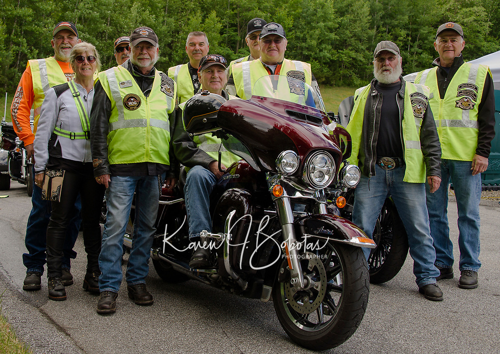 """Our local Winnipesaukee Chapter of Harley Davidson owners organized a """"Ride to the Sky"""" starting from Laconia Harley Davidson in Meredith riding to Mt. Washington on Thursday morning.  (l-r back row Mike Gregory, Joe Monti, Joe Newman and Ed Allard.  Front row Julie Klinger, Ron Egalka, Dave Broughton, Bruce Klinger, Thom Cady and Fran Maineri.  (Karen Bobotas/for the Laconia Daily Sun)"""
