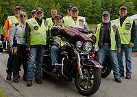 "Our local Winnipesaukee Chapter of Harley Davidson owners organized a ""Ride to the Sky"" starting from Laconia Harley Davidson in Meredith riding to Mt. Washington on Thursday morning.  (l-r back row Mike Gregory, Joe Monti, Joe Newman and Ed Allard.  Front row Julie Klinger, Ron Egalka, Dave Broughton, Bruce Klinger, Thom Cady and Fran Maineri.  (Karen Bobotas/for the Laconia Daily Sun)"