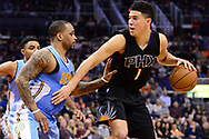 Jan 28, 2017; Phoenix, AZ, USA; Phoenix Suns guard Devin Booker (1) handles the ball against Denver Nuggets guard Jameer Nelson (1) in the second half of the NBA game at Talking Stick Resort Arena. The Nuggets won 123-112. Mandatory Credit: Jennifer Stewart-USA TODAY Sports
