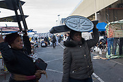 Londoners carrying purchased items, Nine Elms market in Vauxhall near the new U.S. Embassy and extensive development, Nine Elms, London. 6 January 2018