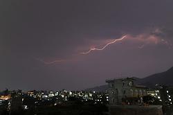 April 26, 2018 - Kathmandu, NP, Nepal - Lightning flashes illuminates the sky during a thunderstorm over  Kirtipur, Kathmandu, Nepal on Thursday, April 26, 2018. (Credit Image: © Narayan Maharjan/NurPhoto via ZUMA Press)