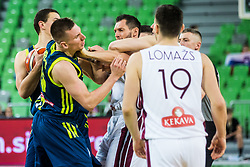 Gregor Hrovat of Slovenia in fight with Janis Blums of Latvia  during basketball match between National teams of Slovenia and Latvia in Round #10 of FIBA Basketball World Cup 2019 European Qualifiers, on December 2, 2018 in Arena Stozice, Ljubljana, Slovenia. Photo by Grega Valancic