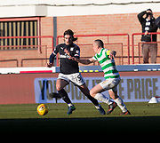 26th December 2017, Dens Park, Dundee, Scotland; Scottish Premier League football, Dundee versus Celtic; Dundee's Jon Aurtenetxe goes past Celtic's Scott Brown