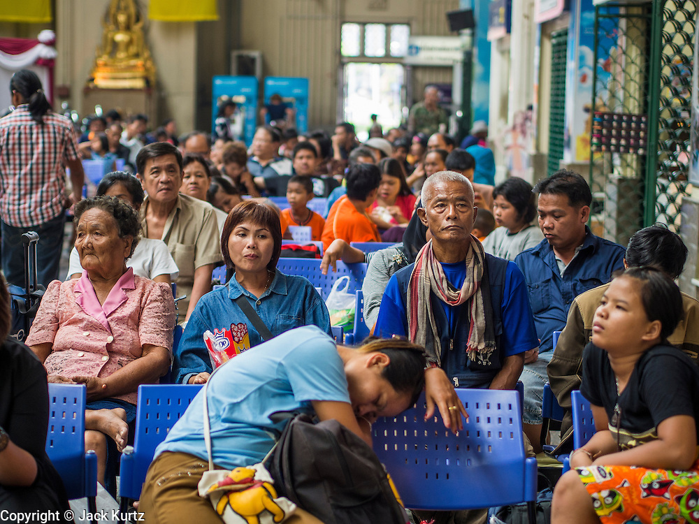 16 APRIL 2014 - BANGKOK, THAILAND: Passengers wait to catch trains in Hua Lamphong Railway Station, the main train station in Bangkok. Thai highways, trains and buses were packed Wednesday as Thais started returning home after the long Songkran break. Songkran is normally three days long but this year many Thais had at least an extra day off because the holiday started on Sunday, so many Thais started traveling on Friday of last week.    PHOTO BY JACK KURTZ