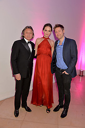 Left to right, LEON MAX, YANA MAX and CHRISTOPHER BAILEY at the Alexandra Shulman and Leon Max hosted opening of Vogue 100: A Century of Style at The National Portrait Gallery, London on 9th February 2016.