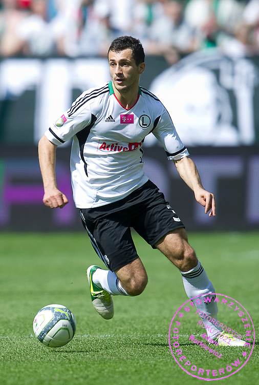 Legia's Tomasz Jodlowiec controls the ball during T-Mobile Extraleague soccer match between Legia Warsaw and Lechia Gdansk at Pepsi Arena in Warsaw, Poland...Poland, Warsaw, May 05, 2013..Picture also available in RAW (NEF) or TIFF format on special request...For editorial use only. Any commercial or promotional use requires permission...Photo by © Adam Nurkiewicz / Mediasport