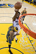 January 31, 2019; Oakland, CA, USA; Philadelphia 76ers center Joel Embiid (21) shoots the basketball against Golden State Warriors center DeMarcus Cousins (0) during the second half at Oracle Arena.