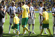 Picture by Paul Chesterton/Focus Images Ltd.  07904 640267.11/9/11.The players shake hands before the Barclays Premier League match at Carrow Road stadium, Norwich.