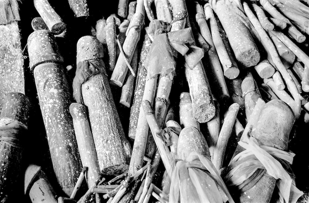 Wooden phalluses (called Lingam) piled up in a cave at Ao Phra Nang beach, in Raileh, Thailand, 2003.<br />