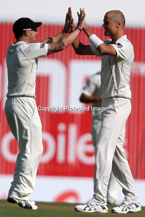 New Zeakand bowler Chris Martin celebrates with  Brendon McCullum after taken Indian batsman VVS Laxman wicket during the 3rd test match India vs New Zealand day-3 Played at Vidarbha Cricket Association Stadium, Jamtha, Nagpur, 22, November 2010 (5-day match)