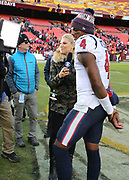 Nov 18, 2018; Landover, MD, USA; CBS sideline reporter Melanie Collins interviews Houston Texans quarterback Deshaun Watson (4) after the game against the Washington Redskins at FedEx Field. The Texans beat the Redskins 23-21. (Steve Jacobson/Image of Sport)