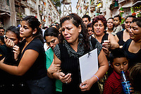 Gloria Cruz, center, and family members mourn the death of her son, 24-year-old Eder Cruz, who was killed by a drug cartel because his family couldn't pay the ransom, at Cementerio General, in Guatemala City, Thursday, March 22, 2012. The remains of 11 Guatemalan citizens were repatriated from Mexico on Wednesday. 193 bodies were found in the Tamaulipas state of northern Mexico in 26 mass graves in April 2011. Mexican authorities believe the dead were mostly migrants kidnapped from buses and killed by the Zetas drug cartel after trying to extort money from their families in Guatemala.