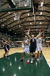 10 January 2009: Lissie McAlvey can't hold on to the rebound as it is taken by Hope Schulte. The Lady Titans of Illinois Wesleyan University downed the and Lady Thunder of Wheaton College by a score of 101 - 57 in the Shirk Center on the Illinois Wesleyan Campus in Bloomington Illinois.