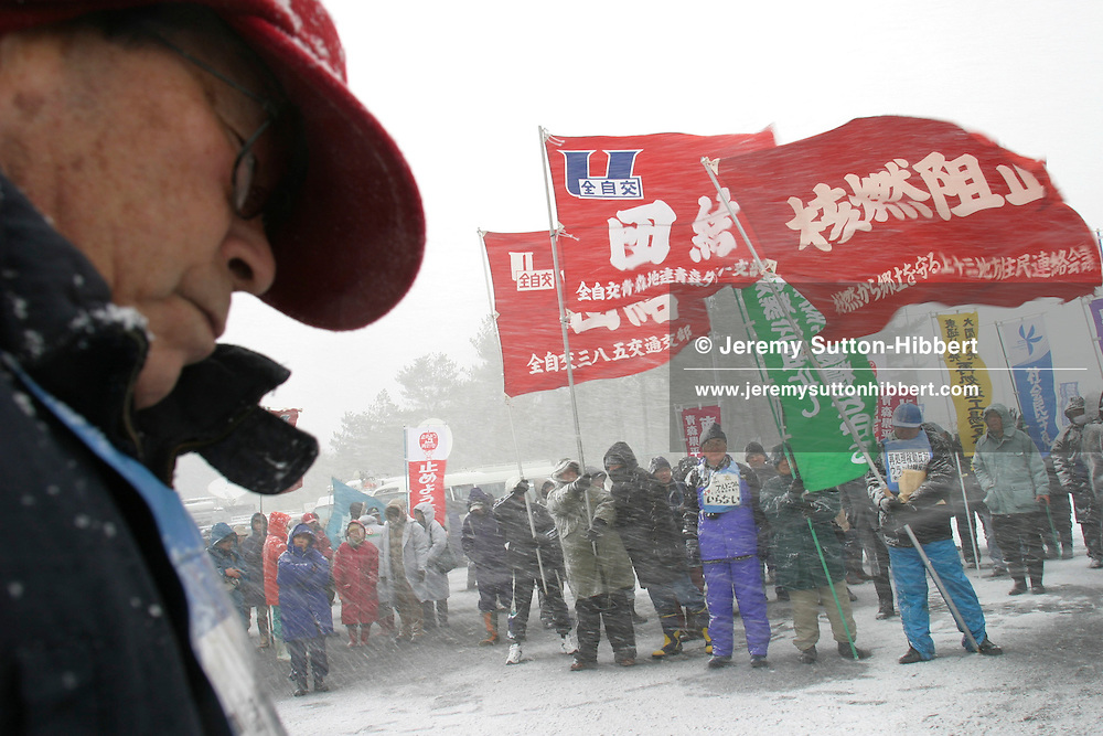 Protesters, including Greenpeace and other NGO's, demonstrate outside the Japan Nuclear Fuel Limited Rokkosho Nuclear Reprocessing Facility against the first tests and reprocessing of depleted uranium in Rokkosho, Aomori, Japan.