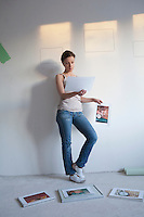 Woman decides on pictures to mount in new apartment